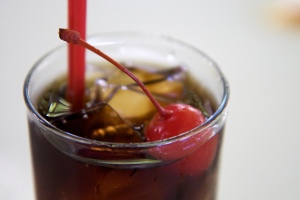 glass of soda with cherry